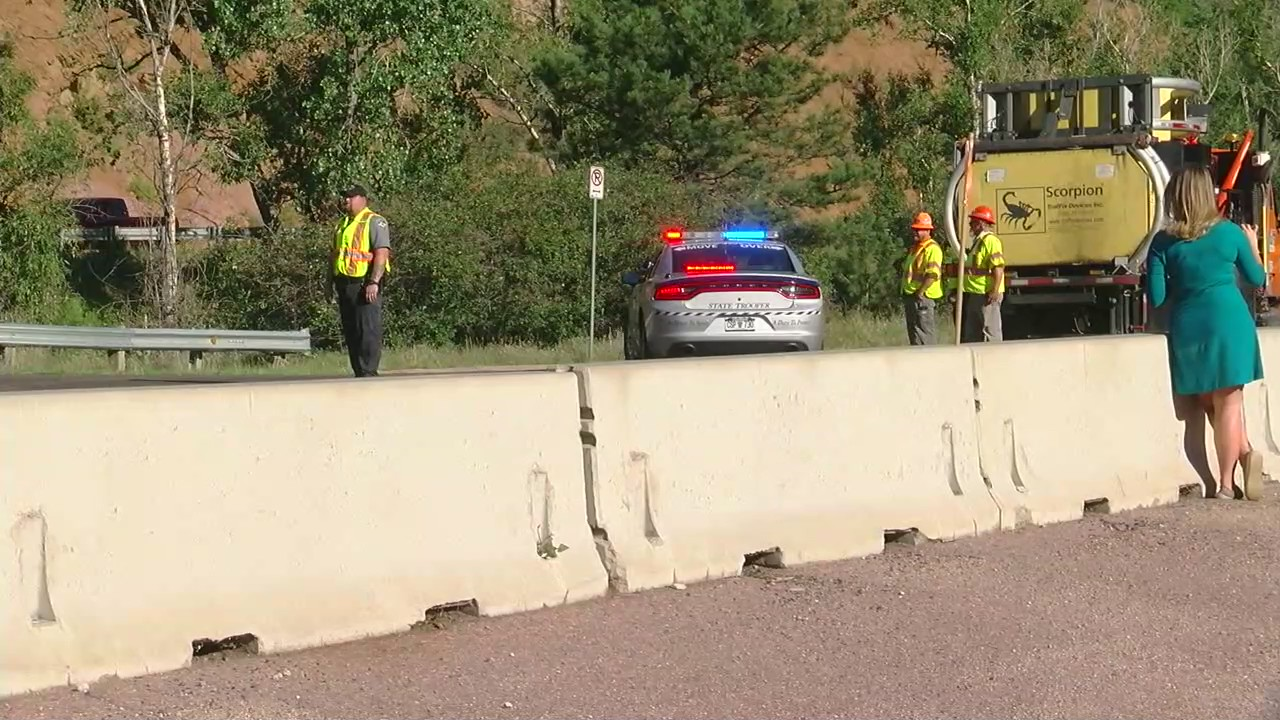 Law enforcement on the scene of a closure on Highway 24 west of Manitou Springs Friday morning. / Joe Swanson - FOX21 News