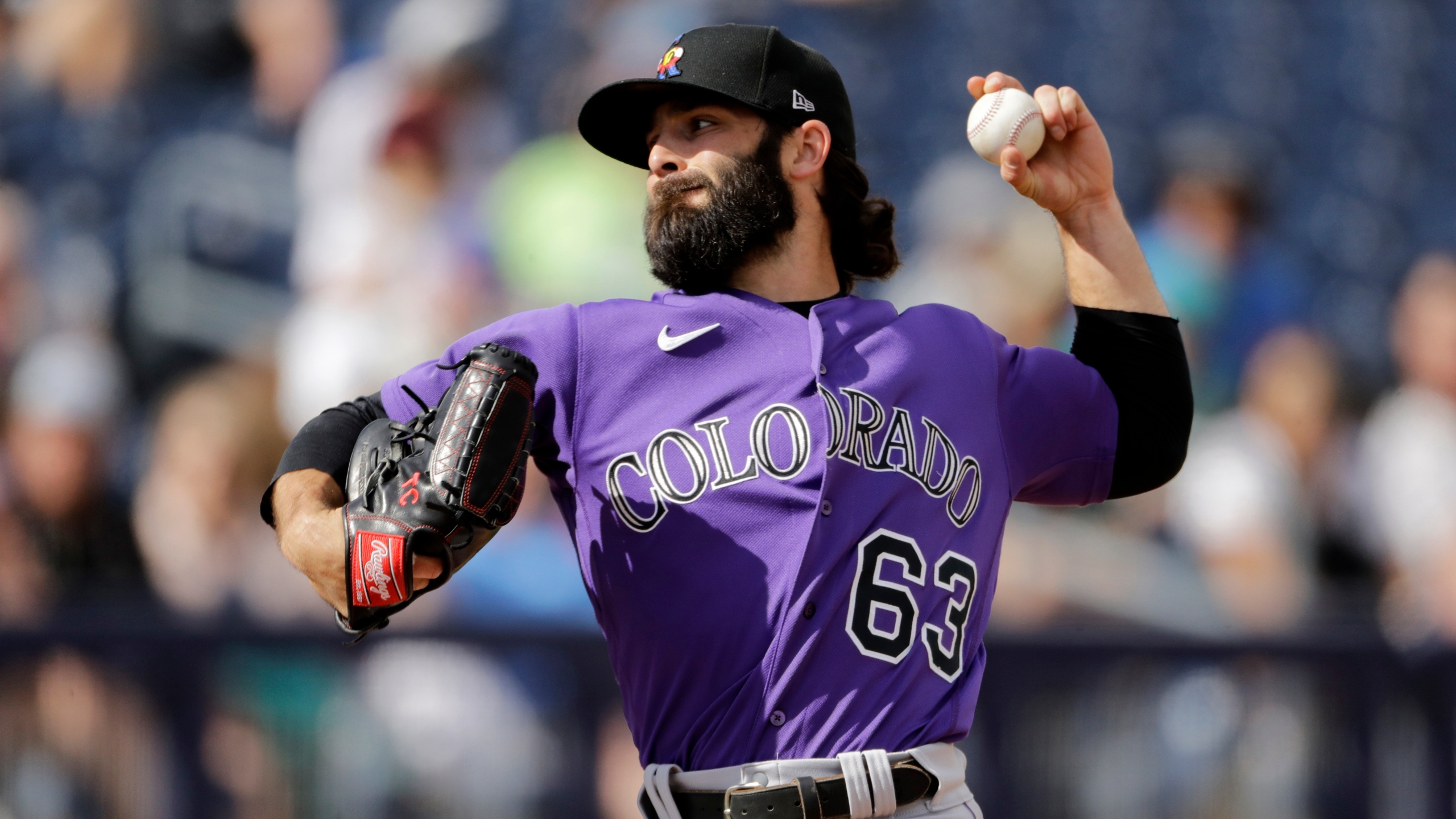 Colorado Rockies pitcher Tim Collins throws during the fifth inning of a spring training baseball game against the Seattle Mariners Monday, March 2, 2020, in Peoria, Ariz. (AP Photo/Charlie Riedel)
