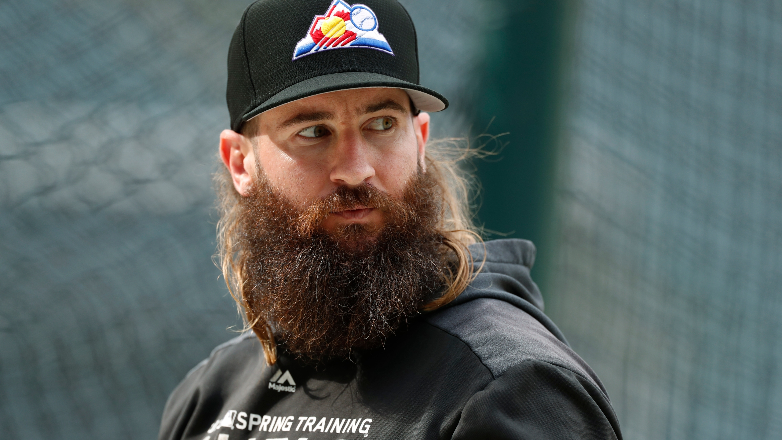 FILE - In this Sept. 11, 2019, file photo, Colorado Rockies right fielder Charlie Blackmon waits to enter the batting cage before the team's baseball game against the St. Louis Cardinals in Denver. (AP Photo/David Zalubowski, File)