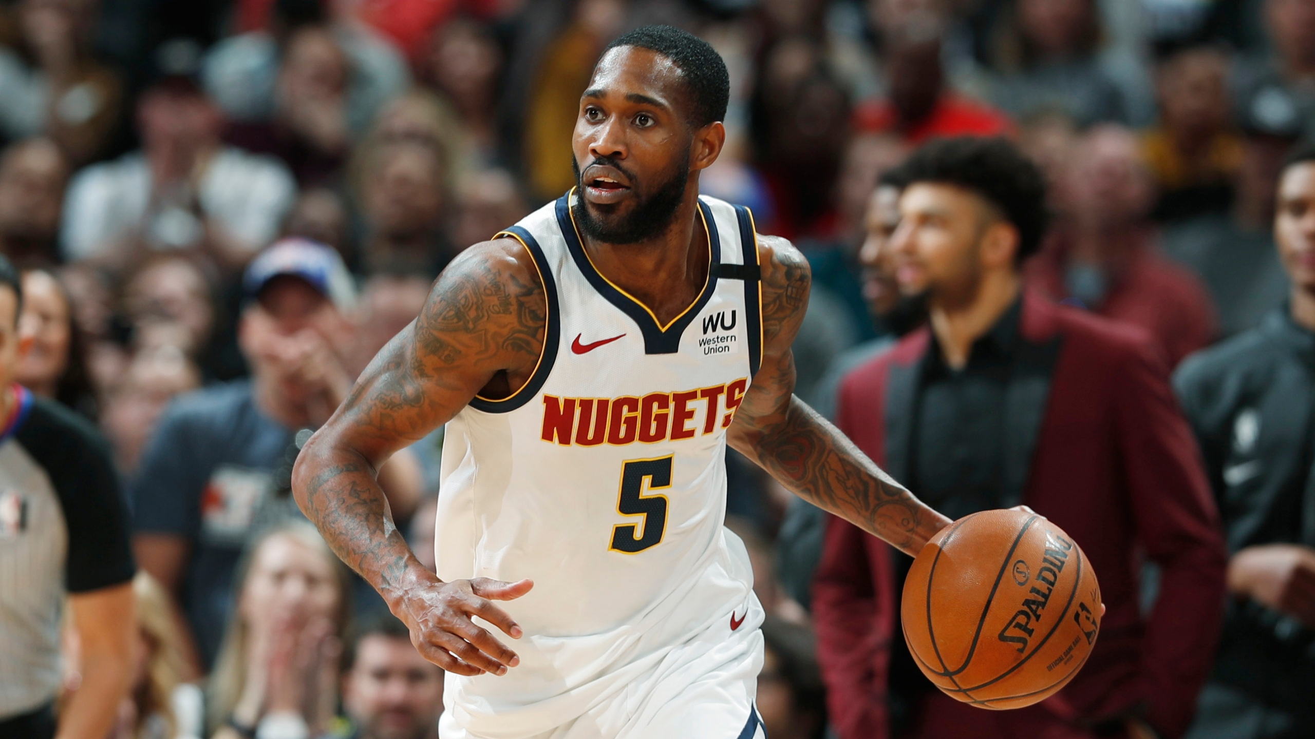 FILE - In this Jan. 26, 2020, file photo, Denver Nuggets' Will Barton (5) is shown in the second half of an NBA basketball game against the Houston Rockets, in Denver. (AP Photo/David Zalubowski, File)