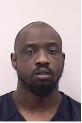 ELIJAH JAMES COGMON is a Black Male, 33 years old, 6' tall, and 210 lbs., with black hair and brown eyes. COGMON is wanted for Controlled Substance, Drug Paraphernalia, Weapon, Firearm Purchase and Habitual Criminal.