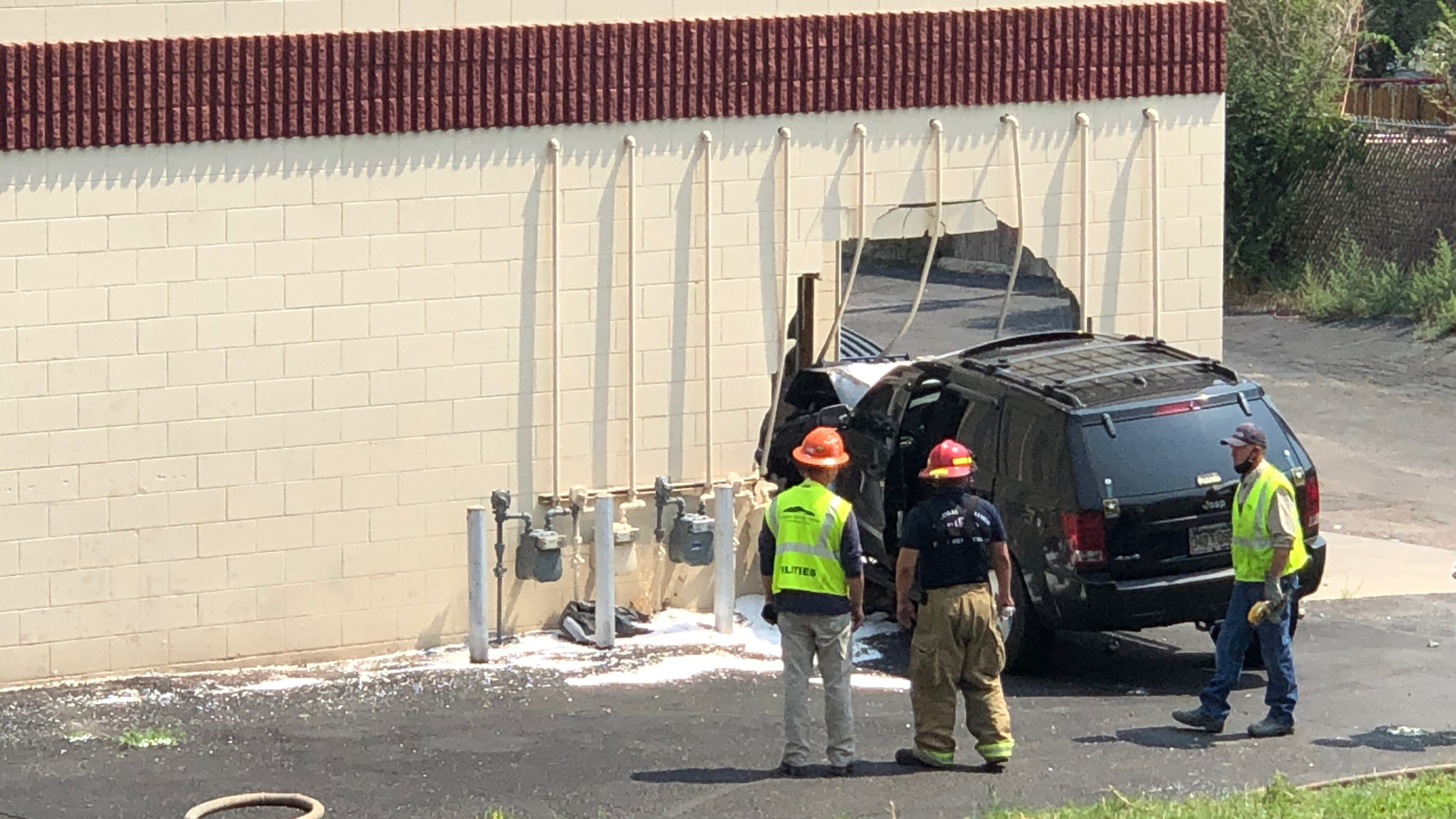 Crews on the scene of a crash that caused a gas leak in the area of Chelton Road and Pine Tree Square Tuesday afternoon. / Mike Duran - FOX21 News
