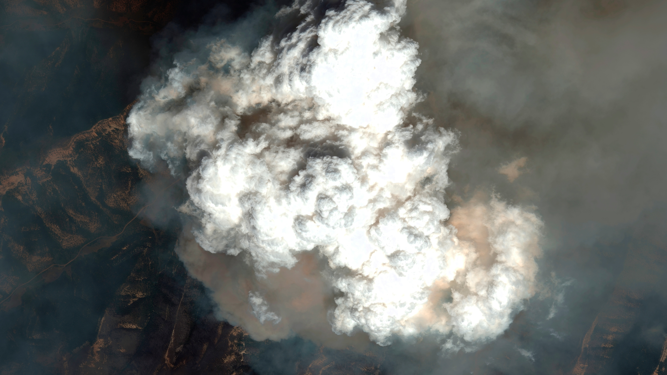 A satellite image provided by Maxar Technologies shows a pyrocumulus cloud from the Pine Gulch fire north of Grand Junction, Colo., Sunday, Aug. 9, 2020. (©2020 Maxar Technologies via AP)