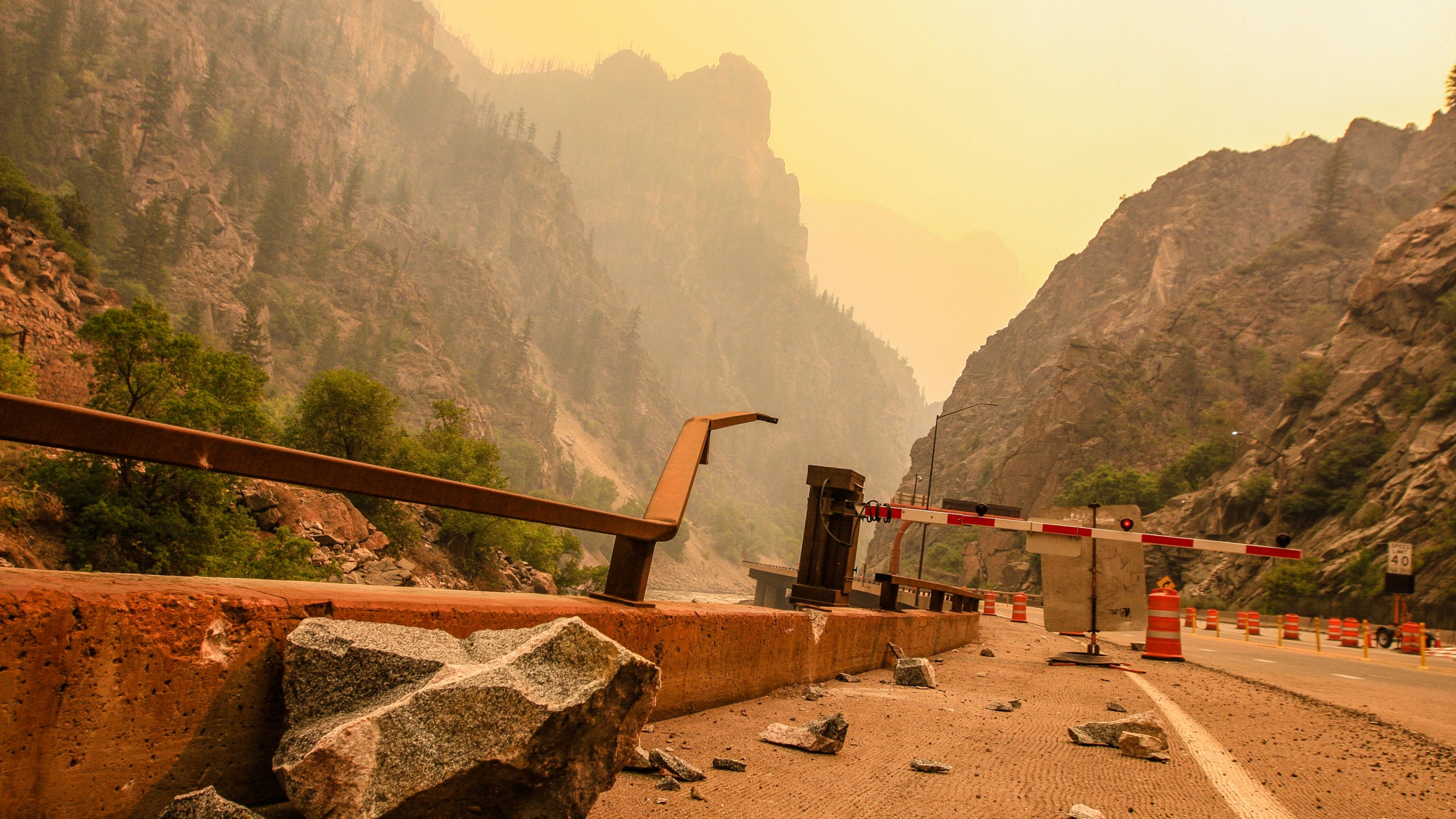 Rock falls continue to pummel Glenwood Canyon as the Grizzly Creek fire moves away Sunday, Aug. 16, 2020, near Glenwood Springs, Colo. With the vegetation burned away, nothing is there to anchor the rocks to the mountainside. (Chris Dillmann/Vail Daily via AP)