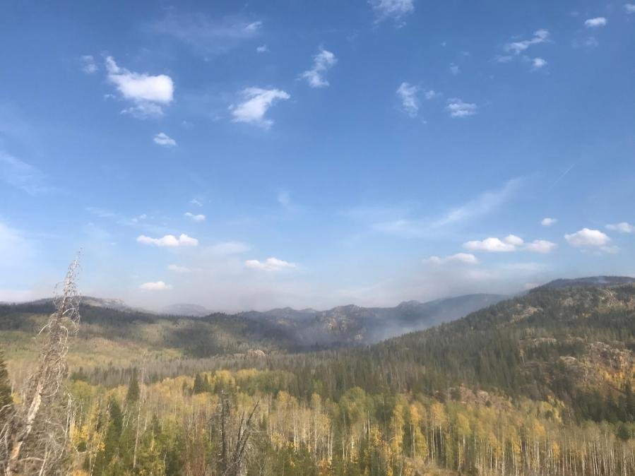 Light smoke rises from Middle Fork drainage Sunday morning, September 20. / Courtesy Middle Fork Fire Information