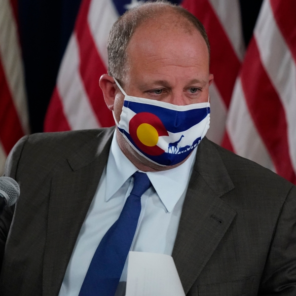 Colorado Governor Jared Polis makes a point during a news conference about the state's efforts against the the new coronavirus Thursday, Sept. 3, 2020, in Denver. (AP Photo/David Zalubowski)