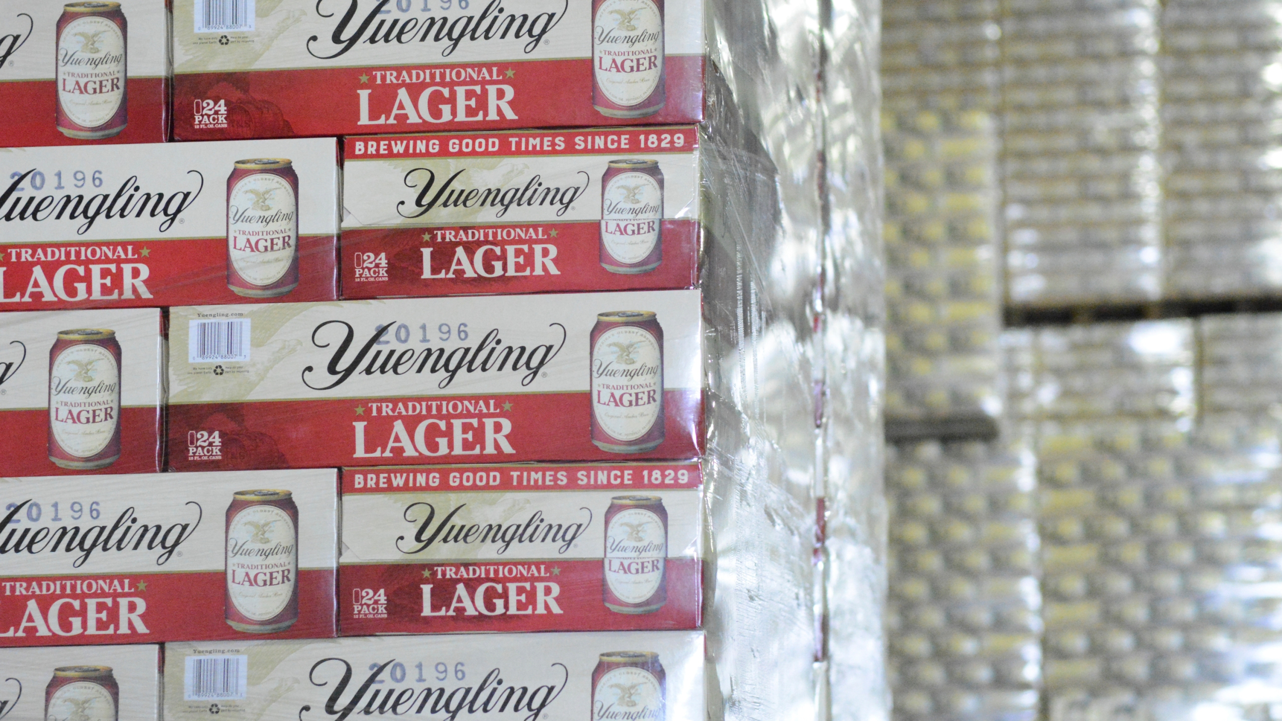 FILE - Cases of canned Yuengling Traditional Lager are stacked in the warehouse of the D.G. Yuengling & Son Brewery Mill Creek plant on Tuesday, July 21, 2020, in Pottsville, Pa.(Lindsey Shuey/Republican-Herald via AP, File)