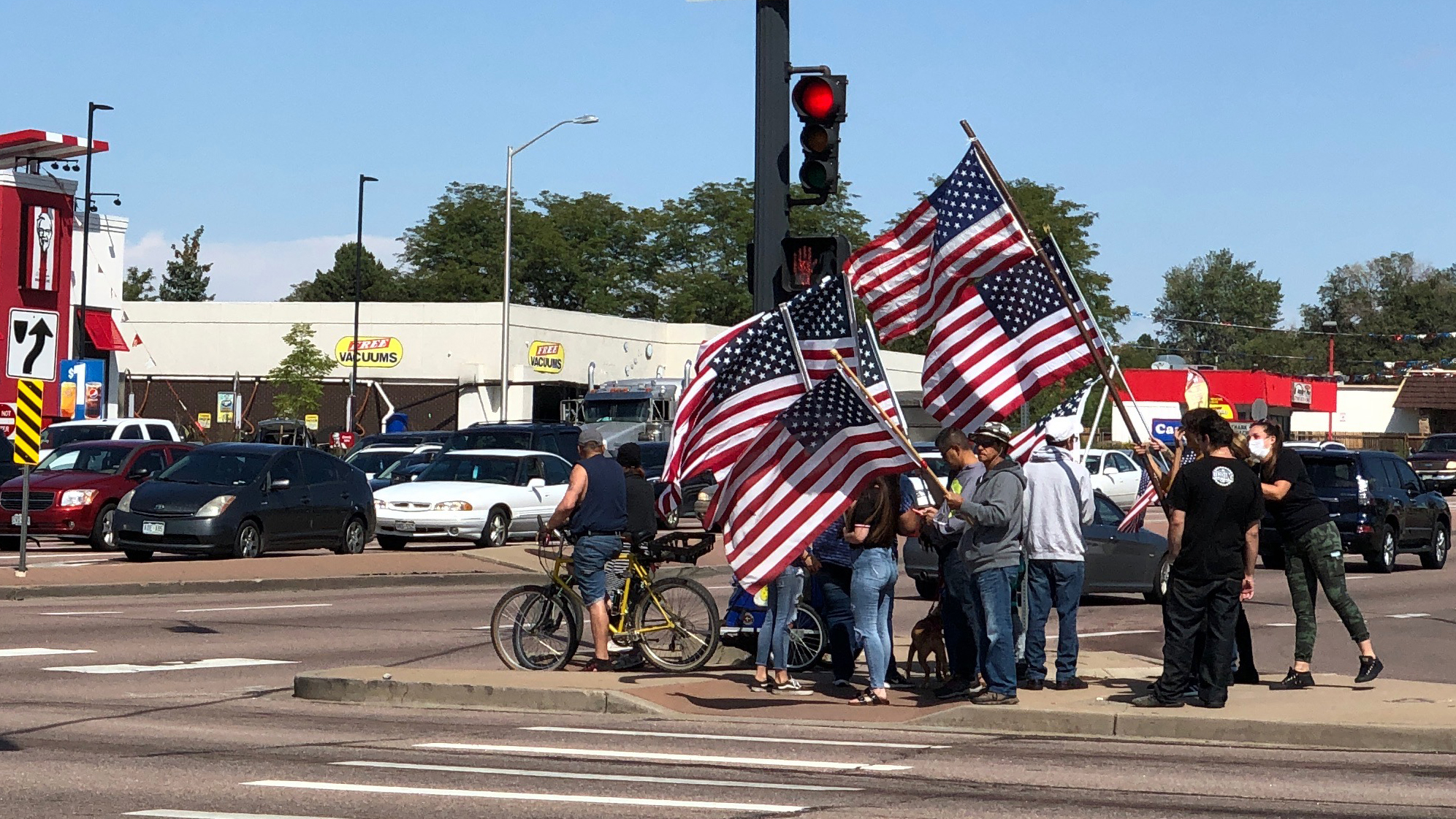 A Colorado Springs family waves flags in honor of 9/11 attack victims at the intersection of Academy Boulevard and Galley Road in Colorado Springs on September 11, 2020. / Mike Duran - FOX21 News