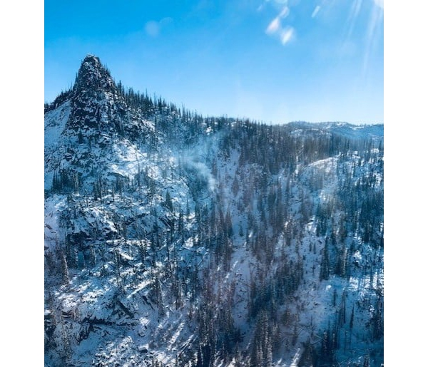 A photo from Wednesday's Middle Fork Fire reconnaissance flight shows an area with some remaining heat and smoke, despite the recent snow. / Courtesy Middle Fork Fire Information