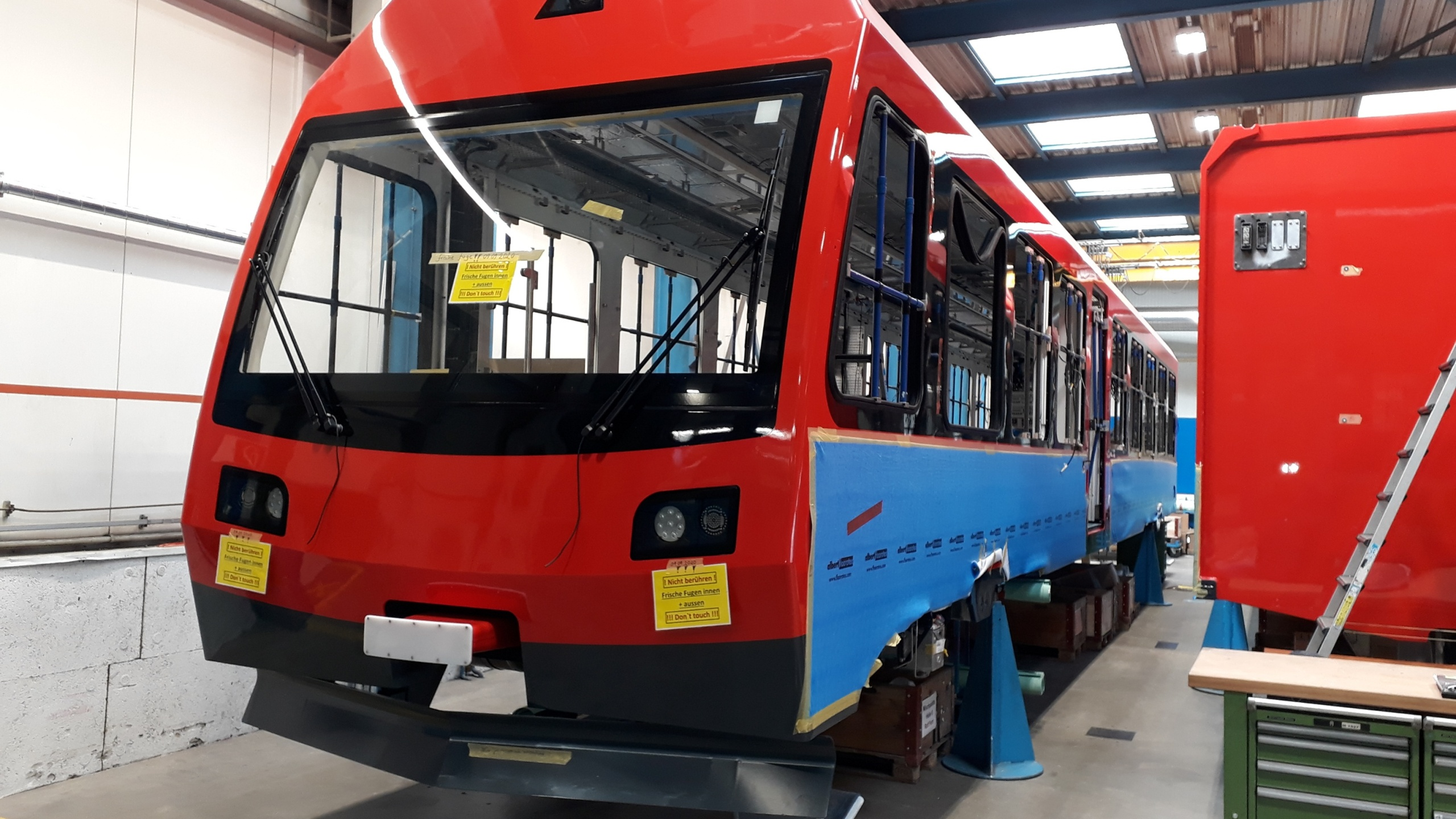 New cog railway cars being assembled in Switzerland. / Courtesy The Broadmoor Manitou and Pikes Peak Cog Railway