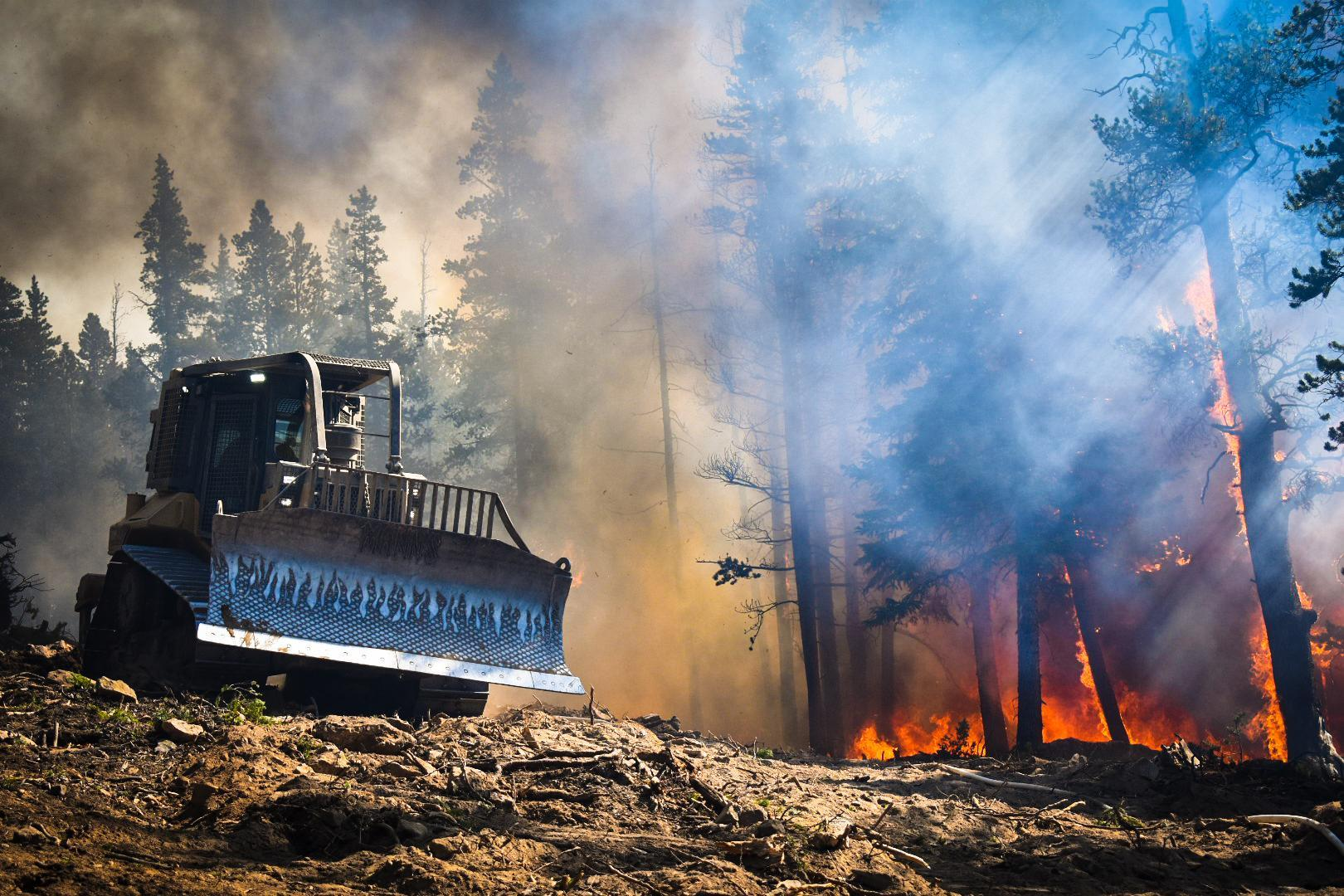 A bulldozer helps the Logan Hotshots during a firing operation on the Cameron Peak Fire. / Courtesy Cameron Peak Fire Information