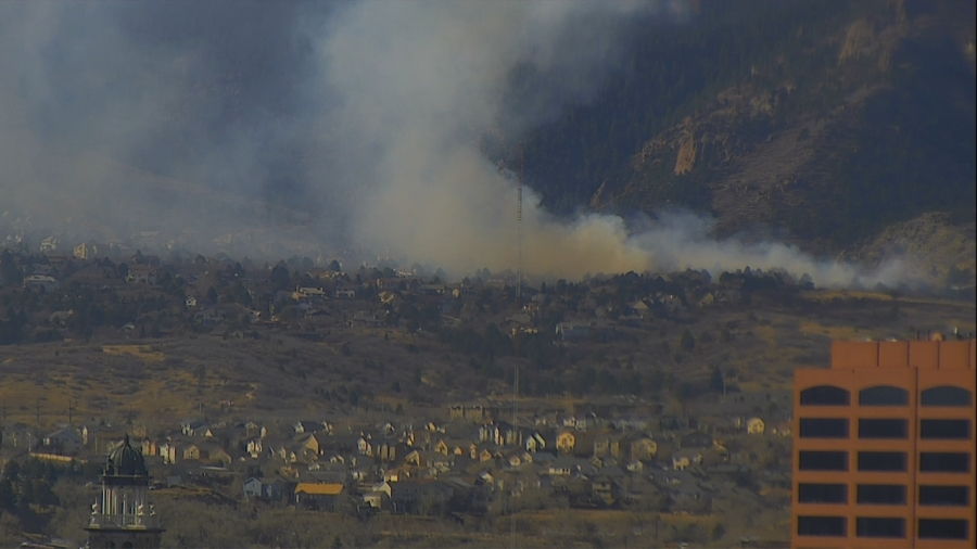 The Bear Creek Fire is visible from downtown Colorado Springs just before noon Thursday.