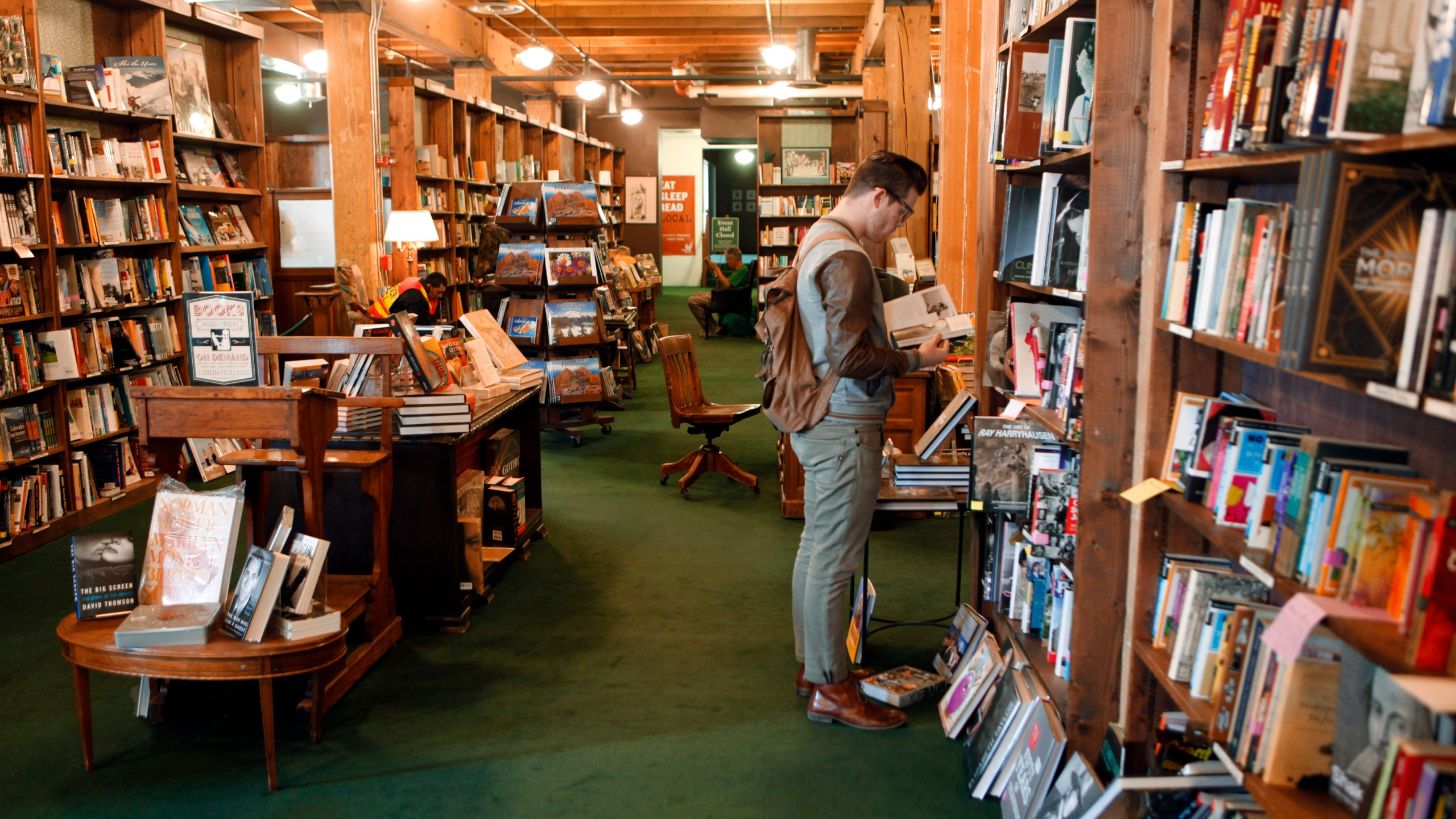 This photo taken on Dec. 7, 2012 shows Bryce Hoogland of Boise, Idaho browsing books at the downtown Tattered Cover book Store in Denver. (AP Photo/Ed Andrieski)