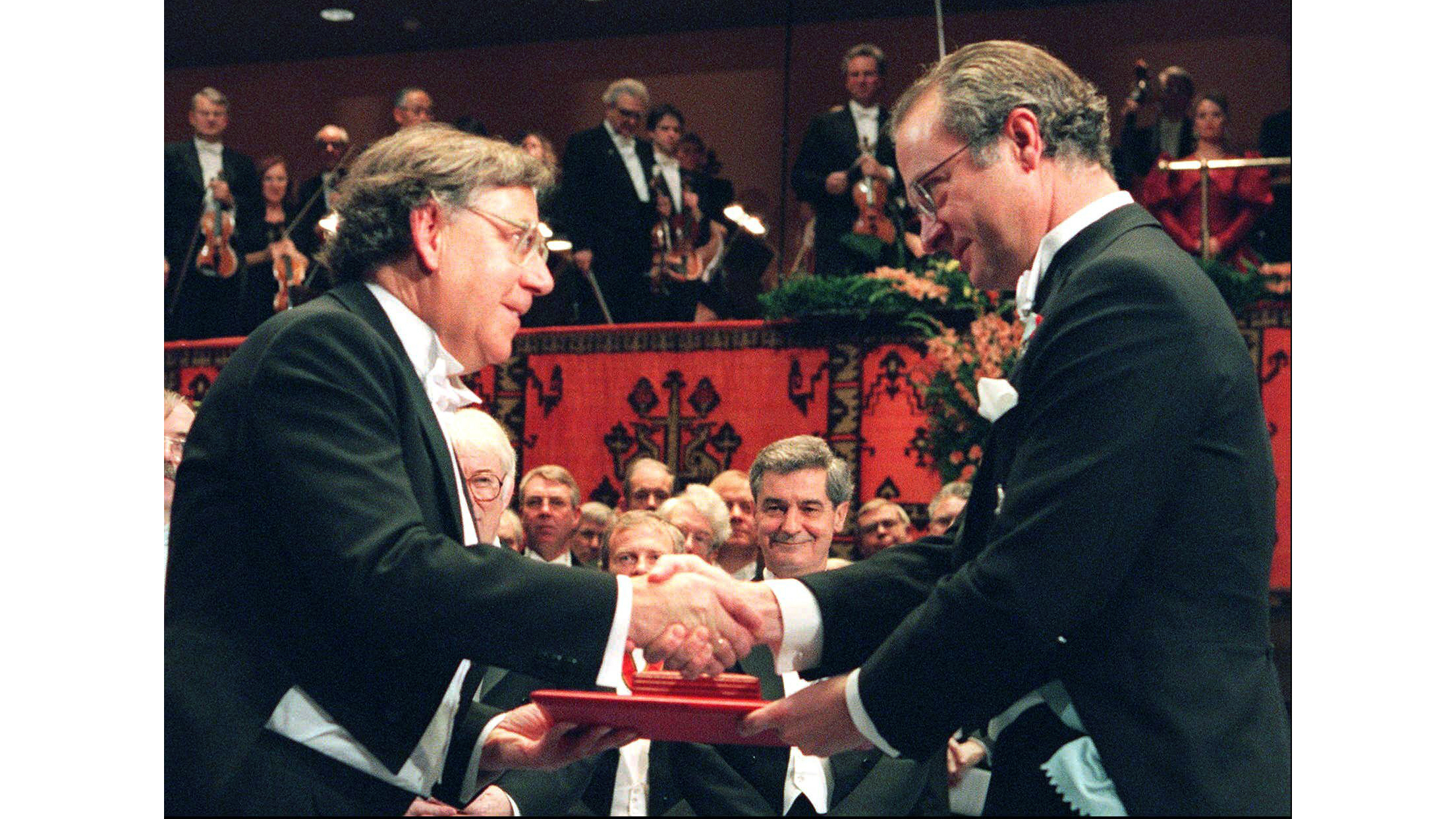 FILE - In this file photo dated December 10 1995, showing Dutch Professor Paul J. Crutzen, left, receiving the Nobel prize for chemistry from Swedish King Carl XVI Gustaf, at the Concert Hall in Stockholm, Sweden. According to a statement from the Max Planck Institute for Chemistry in Germany, Dutch scientist Paul J. Crutzen, who won the Nobel Prize for chemistry for his work understanding the ozone hole, died Thursday Jan. 28, 2021, at the age of 87. (AP photo/Eric Roxfelt, FILE)