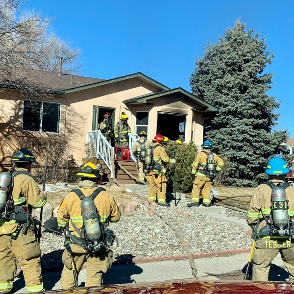Firefighters respond to a house fire in southwestern Colorado Springs Tuesday morning. / Courtesy Colorado Springs Fire Department
