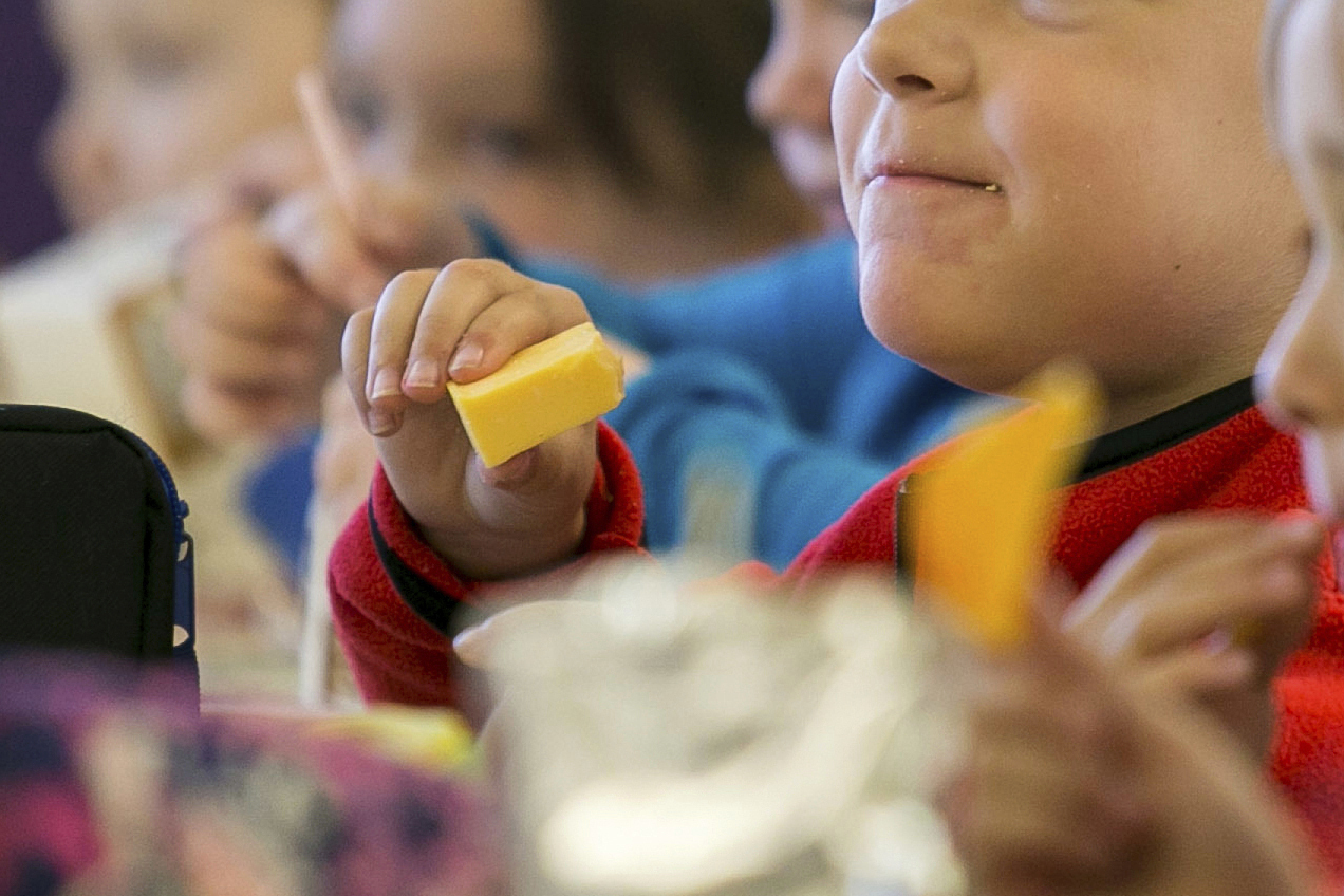 FILE - In this Monday, Oct. 29, 2018, file photo, kids eat lunch at an elementary school in Paducah, Ky. ((Ellen O'Nan/The Paducah Sun via AP, File)
