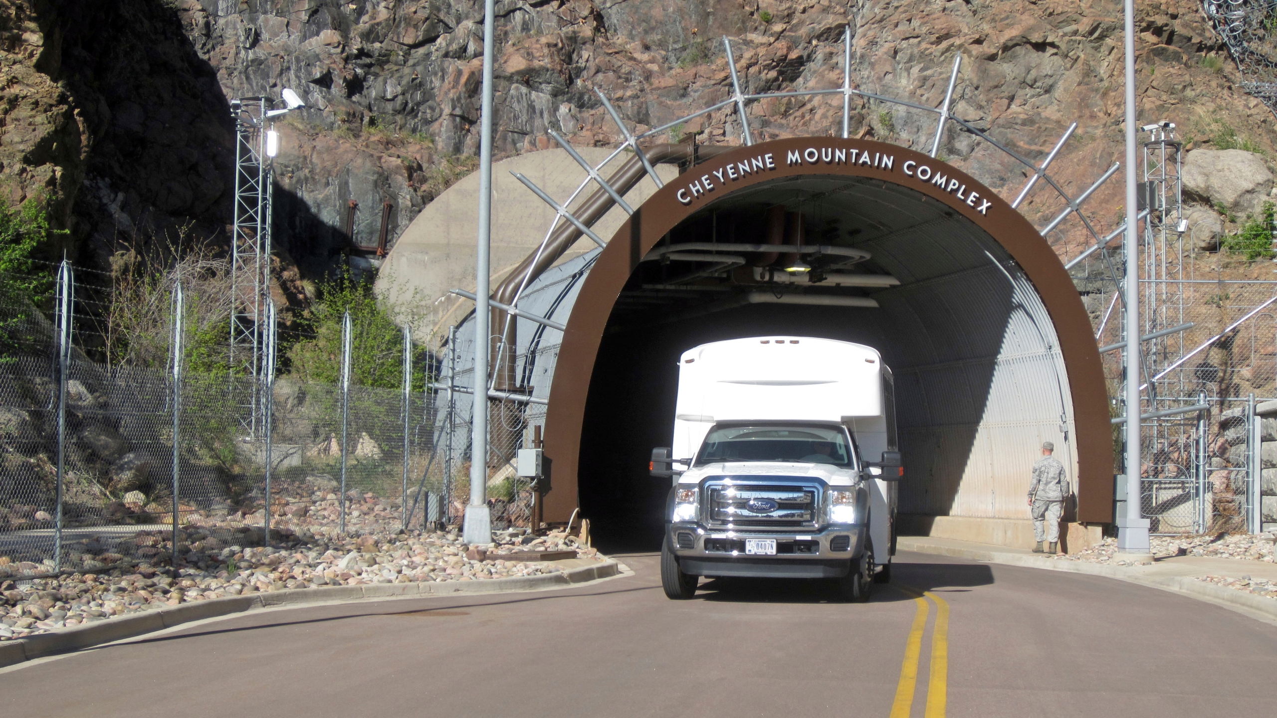 In this Thursday, May 10, 2018 photo, a crew bus leaves the the Cheyenne Mountain Air Force Station complex outside Colorado Springs, Colo. (AP Photo/Dan Elliott)