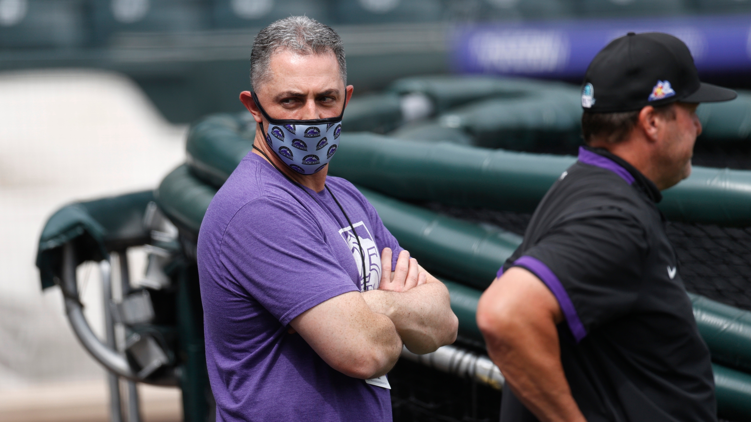 Colorado Rockies general manager Jeff Bridich looks on as players warm up as the team practices in Coors Field Saturday, July 4, 2020, in Denver. (AP Photo/David Zalubowski)