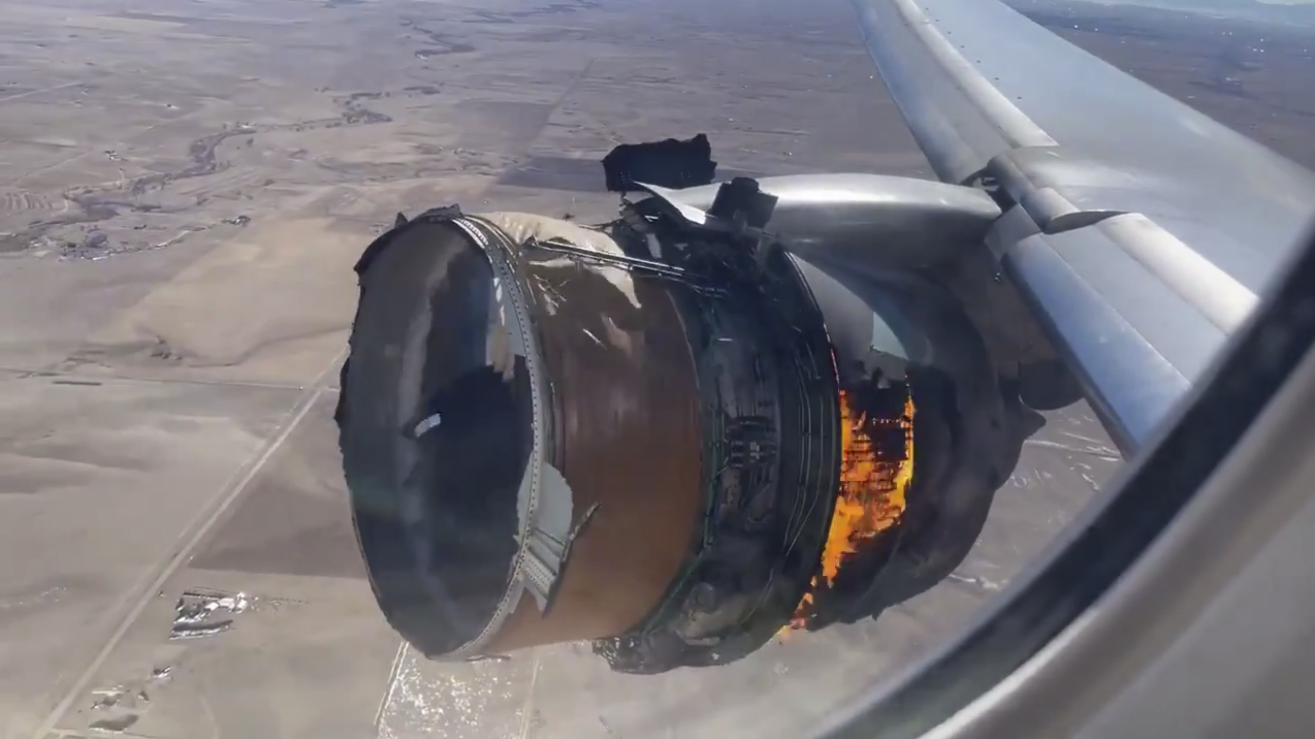 "FILE - In this file photo taken from video, the engine of United Airlines Flight 328 is on fire after experiencing ""a right-engine failure"" shortly after takeoff from Denver International Airport, Saturday, Feb. 20, 2021, in Denver, Colo. (Chad Schnell via AP, File)"