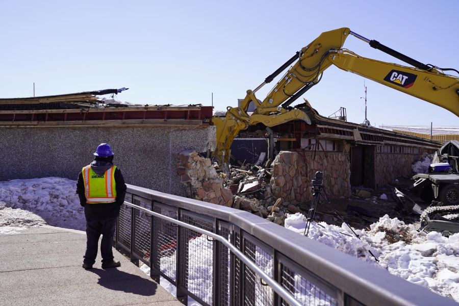 Crews demolish the 1960s-era Pikes Peak Summit House Tuesday, April 6, 2021. / Courtesy City of Colorado Springs
