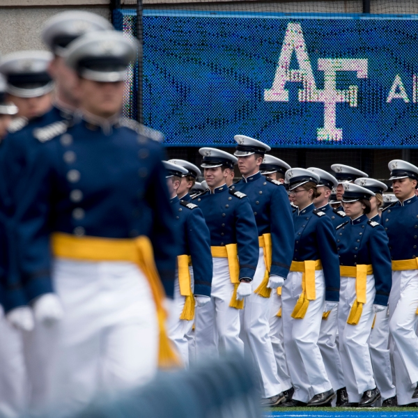 FILE - In this May 30, 2019 file photo, Air Force Cadets arrive at the 2019 United States Air Force Academy Graduation Ceremony at Falcon Stadium at the United States Air Force Academy, in Colorado Springs, Colo. (AP Photo/Andrew Harnik, File)