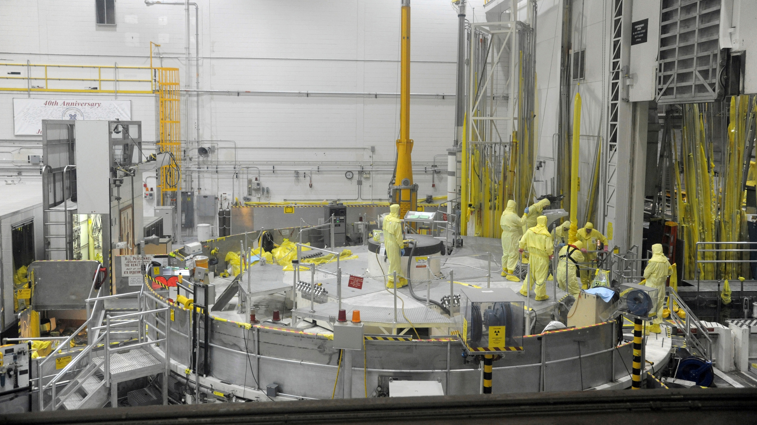 In this May 7, 2013 photo released by Idaho National Laboratory shows Nuclear operations professional personnel work above the Advanced Test Reactor at Idaho National Laboratory's desert site about 50 miles west of Idaho Falls, Idaho. The small cylindrical section in the center of the platform has access ports that allow access to the reactor core for refueling and experiment loading and unloading during routine outages. (Idaho National Laboratory via AP)