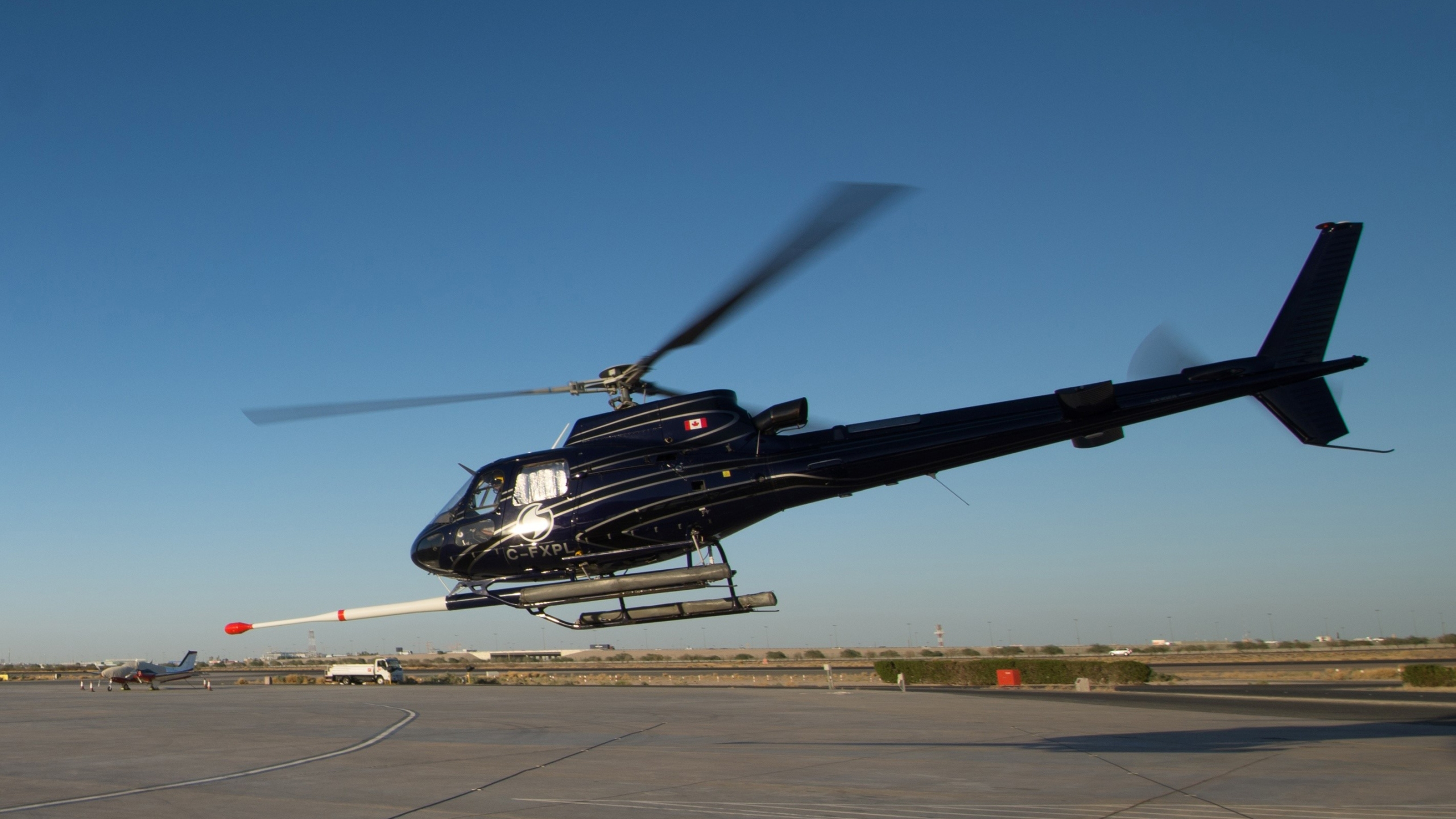 """Sander Geophysics Limited helicopter with a """"stinger"""" that senses the magnetic field. / Photo courtesy SGL"""