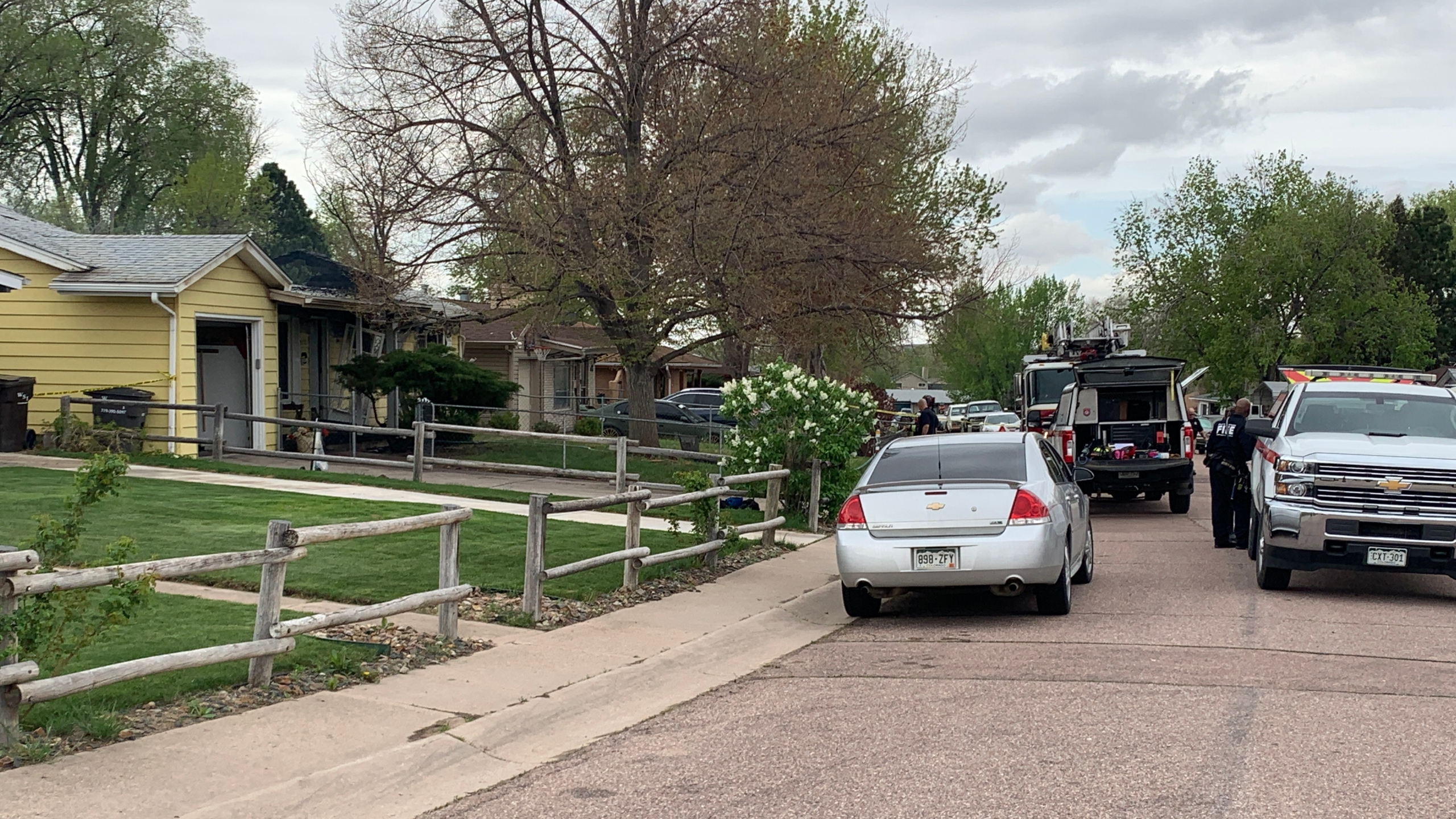 Investigators on the scene of a house fire that killed one person in Security Monday morning. / Sarah Hempelmann - FOX21 News