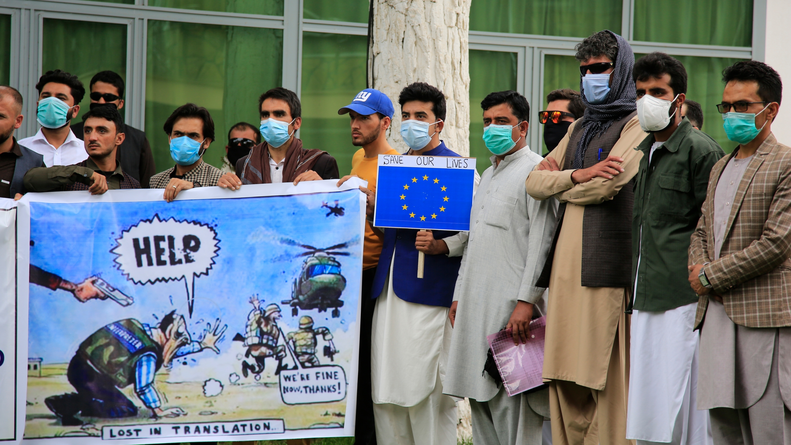 In this Friday, April 30, 2021, photo, former Afghan interpreters hold placards during a protest against the U.S. government and NATO in Kabul, Afghanistan. (AP Photo/Mariam Zuhaib)