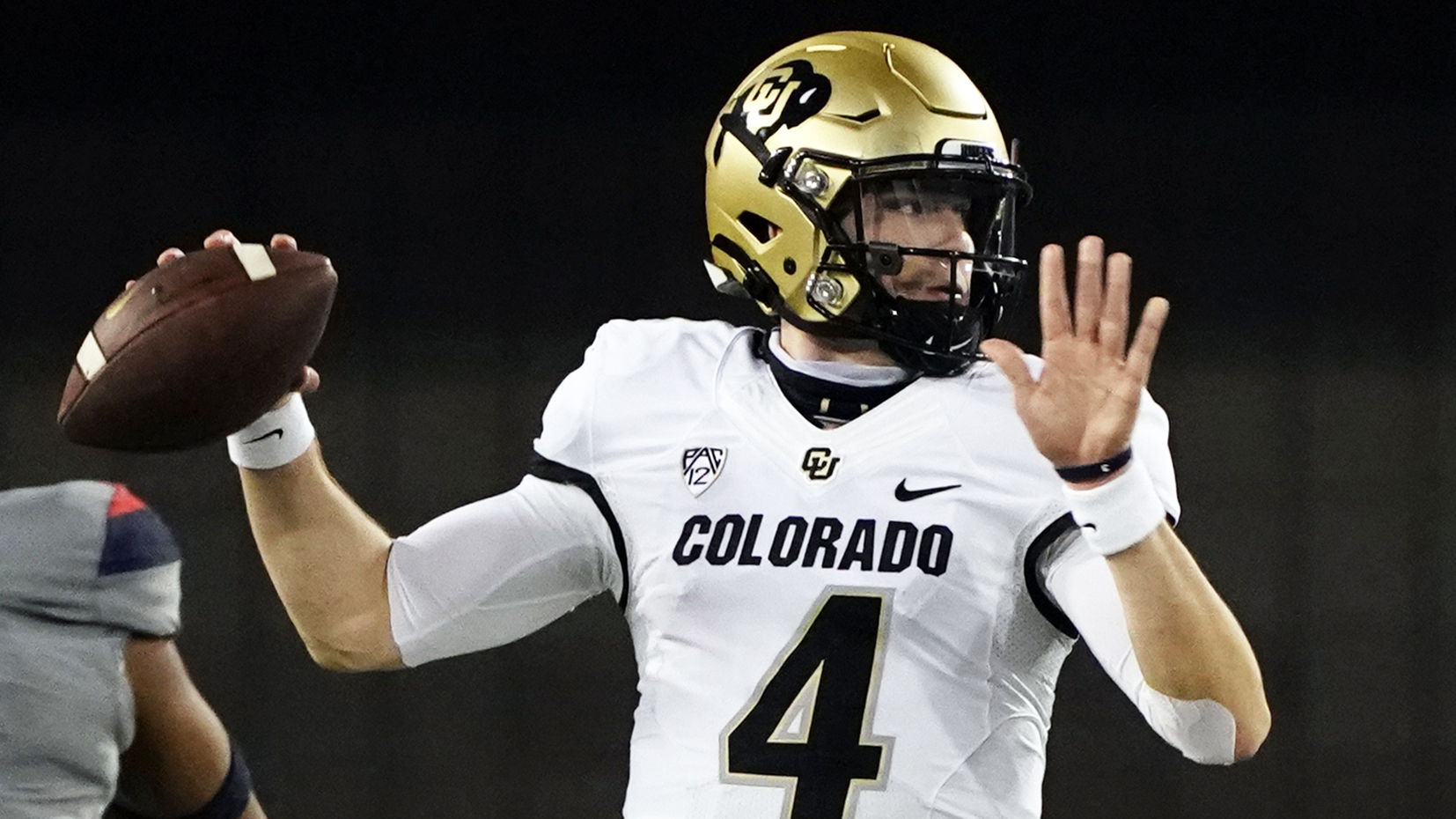 FILE - Colorado quarterback Sam Noyer (4) looks to pass against Arizona in the first half of an NCAA college football game against Arizona in Tucson, Ariz., in this Saturday, Dec. 5, 2020, file photo. (AP Photo/Rick Scuteri, File)