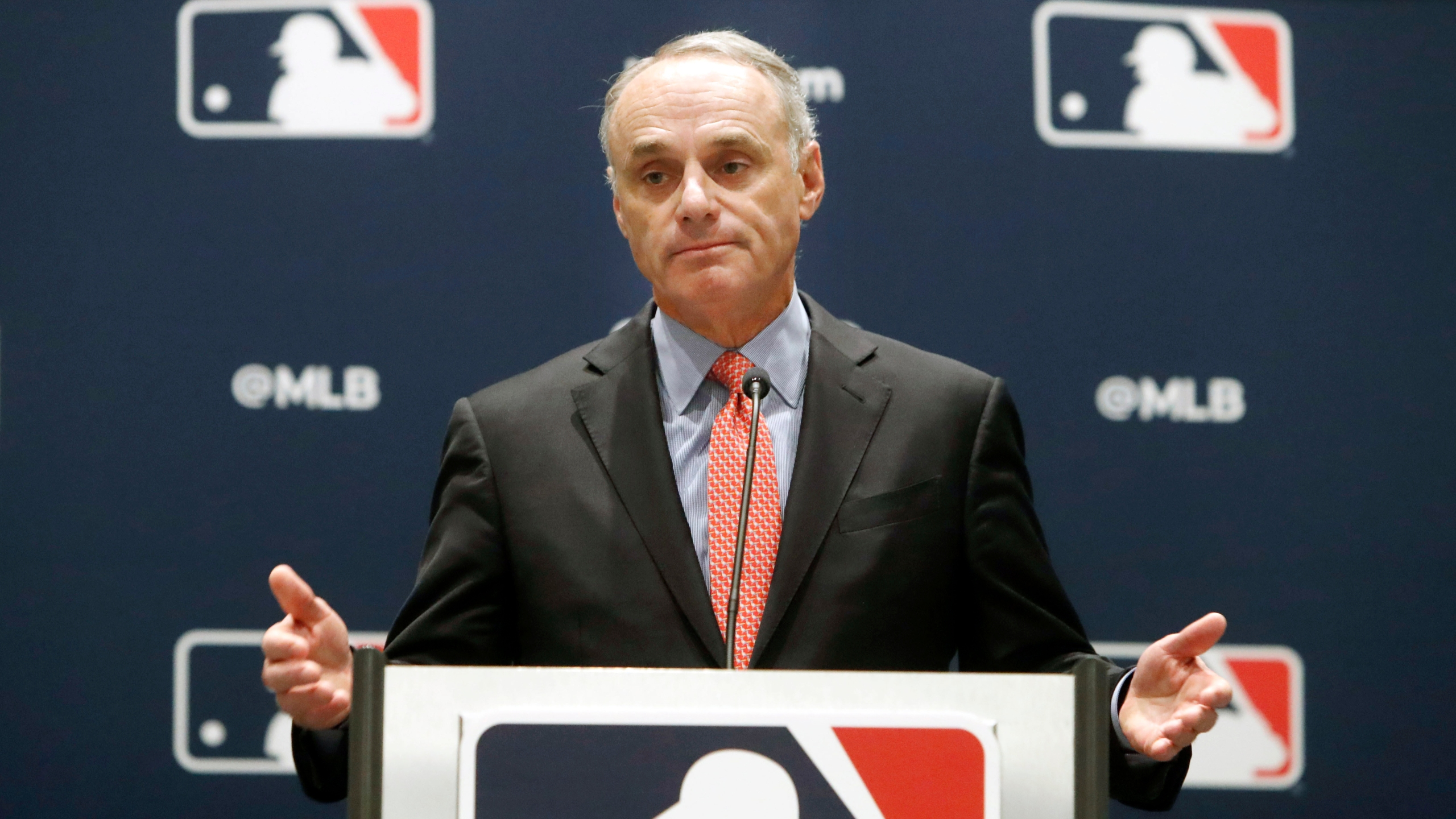 FILE - In this Nov. 21, 2019, file photo, baseball commissioner Rob Manfred speaks to the media at the owners meeting in Arlington, Texas. (AP Photo/LM Otero, File)