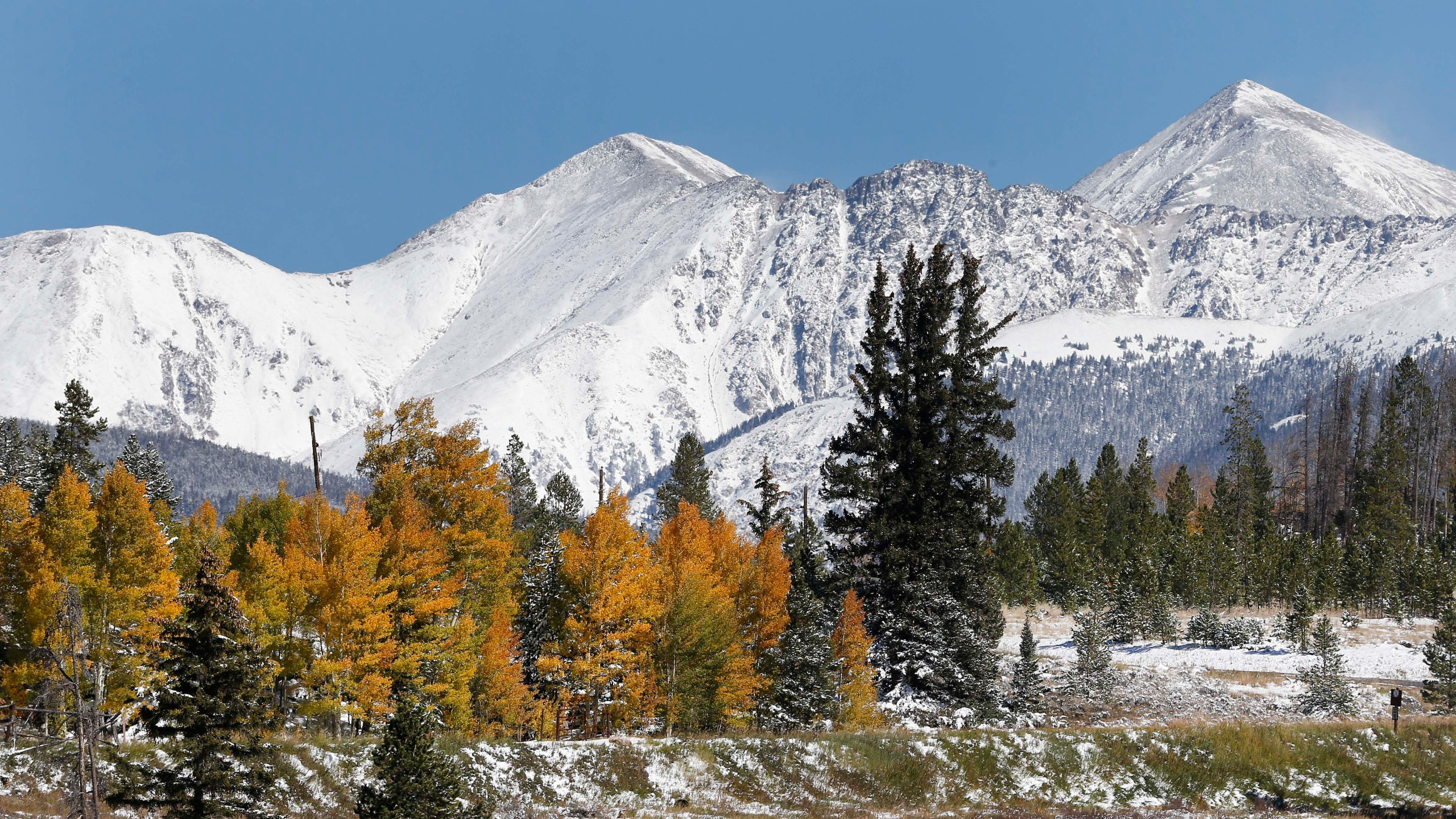 FILE - In this Oct. 5, 2013 file photo, fresh snow covers Torreys Peak, right, and Grizzly Peak, left, east of Frisco, Colo. (AP Photo/Brennan Linsley, file)