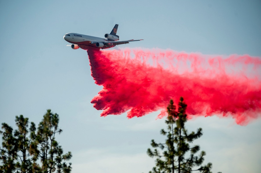FILE - In this July 2, 2021, file photo a DC-10 air tanker drops retardant while battling the Salt Fire near the Lakehead community of Unincorporated Shasta County, Calif. (AP Photo/Noah Berger, File)