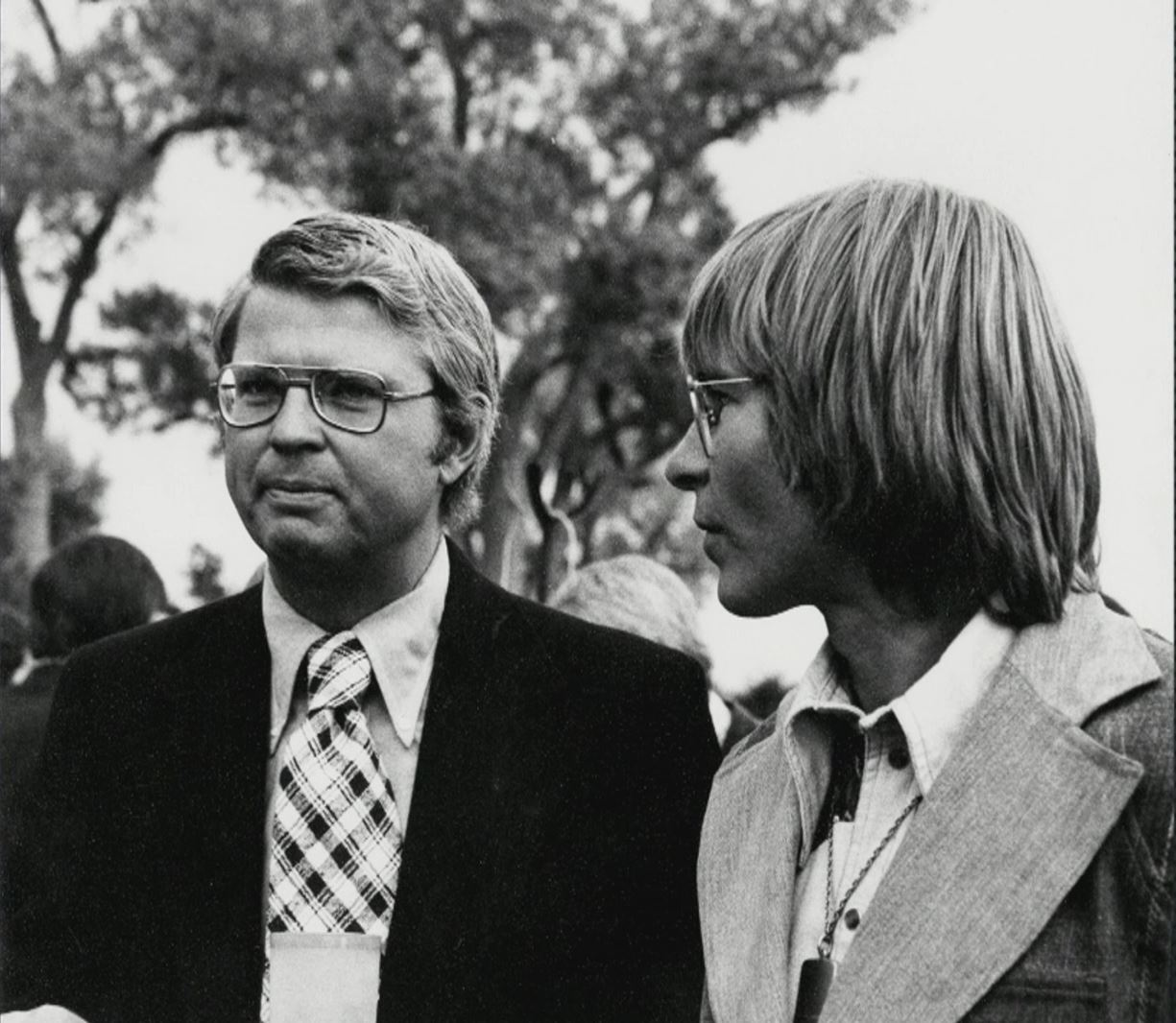 Governor Dick Lamm (left) standing with John Denver (right)